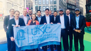 Students Holding UNC Kenan-Flagler Business School Flag in New York City