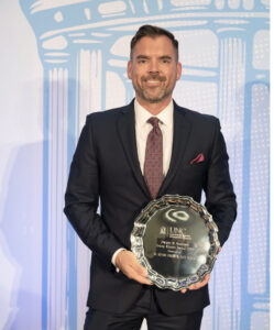 Adam Brown receiving award at UNC Kenan-Flagler business school