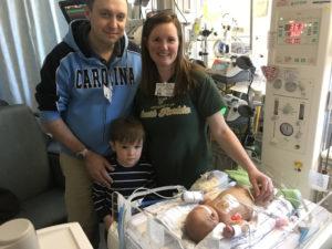 Scott, Debra and their oldest child Scott visit Michael at UNC Children's Hospital.