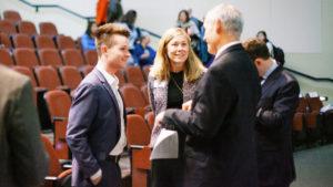 Graeme Strickland speaking with Dean Shackleford in Koury auditorium
