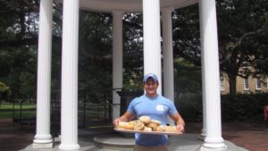 Alex Brandwein holding a tray of bagels