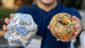 Alex Brandwein holding a bagel