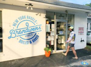 Customer walks into Brandwein's Bagels shop
