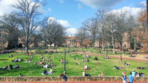 Students Sitting On Lawn At UNC Chapel Hill