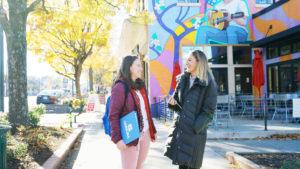 Two Women Talking On Sidewalk In Chapel Hill NC