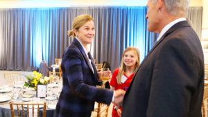Jill Ellis Shakes Hands With Dean Doug Shackelford at UNC Kenan-Flagler 2020 Weatherspoon Leacture