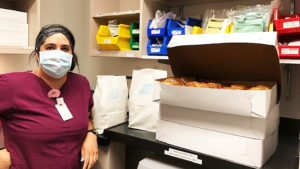 Nurse Standing With Brandweins Bagels During COVID
