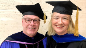 Nick Didow smiles Caludia Malhotra at 2019 UNC Kenan-Flagler Commencement