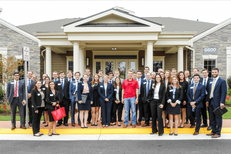 After a whirlwind tour of Avalon Falls Church, UNC Real Estate Club members join David Bookhout (MBA '15), development manager with AvalonBay Communities, for a group picture in front of the community clubhouse.