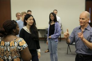 UNC Kenan-Flagler Business School professor Greg Hohn (BA '85) works with his Applied Improv students.