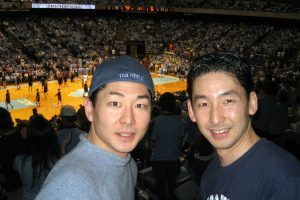Kane Nakamura cheering on the Tar Heels with his brother