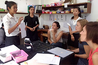 Cambodian women and Kenan-Flagler students meeting together